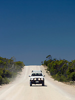 Off road vehicle driving along a dusty road on the Eyre Peninsula, South Australia, Australia