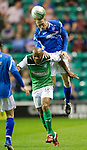 Hibs v St Johnstone...28.09.11   SPL Week.Steven Anderson gets above Junior Agogo.Picture by Graeme Hart..Copyright Perthshire Picture Agency.Tel: 01738 623350  Mobile: 07990 594431