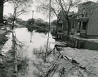 1953 October 23..Assisted Housing..Tidewater Gardens (6-2 & 6-9)...Slum Conditions.Flooded Street..PHOTO CRAFTSMEN INC..NEG# 18-640.NRHA# 643..