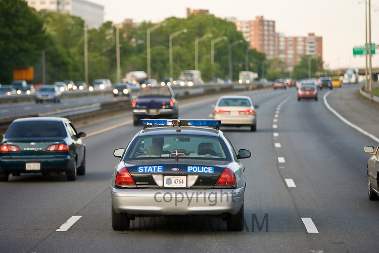 State Police car travelling among volume of traffic on freeway, outskirts of Washington DC, USA