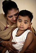 Surrogate mother for first western couple, Rabina Mondal (31) poses for a photograph with her son, Sahil at her home in Anand, Gujarat, India. The centre has become the most popular clinic for outsourcing pregnancies by western couples.