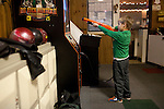 A boy plays video games at Rolling Greens bowling alley in Scotia, NY, on Saturday, December 26, 2009.