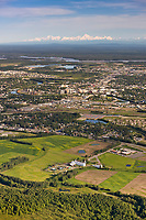 Aerial of the city of Fairbanks, Creamer's field in the foreground and the Alaska range mountains in the distance.