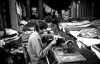 Roma  Dicembre 1990.Ex Pastificio Pantanella occupato da centinaia di immigrati asiatici provenienti dal Pakistan e Bangladesh..Il sarto..Rome Decenber1990.Ex Pastificio Pantanella occupied by hundreds of Asian immigrants from Pakistan and Bangladesh..Tailor
