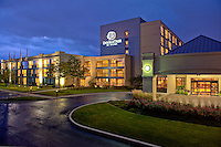The DoubleTree by Hilton Hotel in Arlington Heights, IL at dusk.