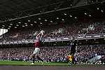 West Ham United 2 Crystal Palace 2, 02/04/2016. Boleyn Ground, Premier League. Home defender Aaron Cresswell taking a throw-in during the first-half at the Boleyn Ground as West Ham United hosted Crystal Palace in a Barclays Premier League match. The Boleyn Ground at Upton Park was the club's home ground from 1904 until the end of the 2015-16 season when they moved into the Olympic Stadium, built for the 2012 London games, at nearby Stratford. The match ended in a 2-2 draw, watched by a near-capacity crowd of 34,857. Photo by Colin McPherson.