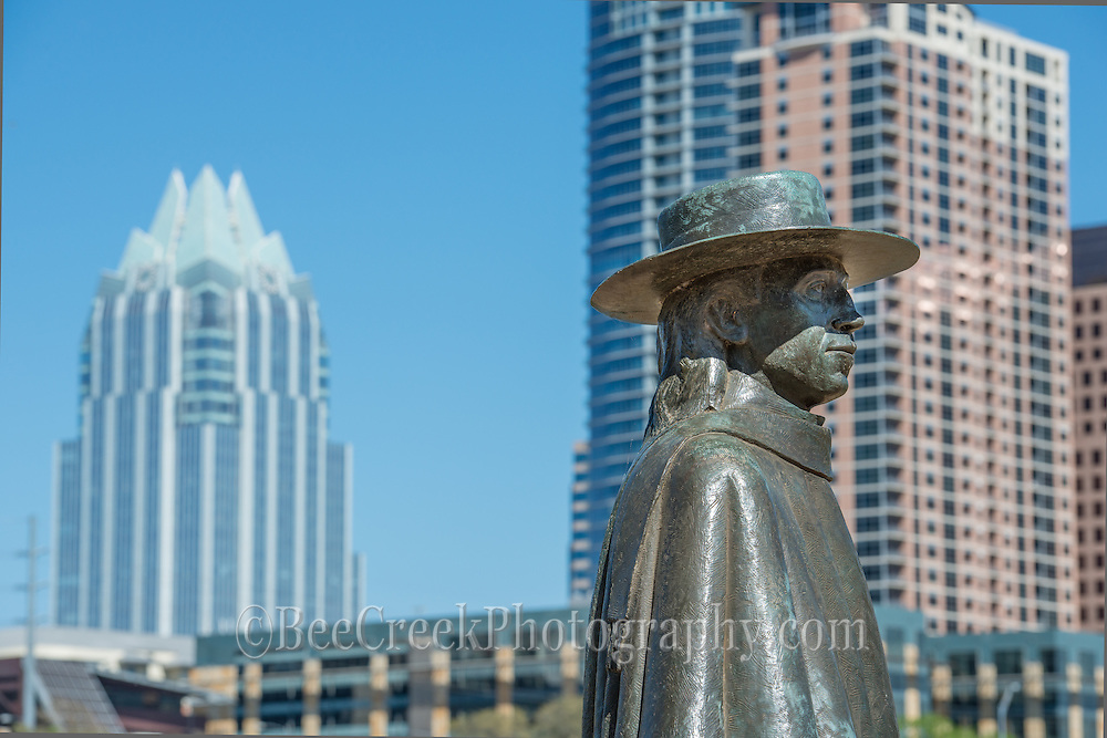 Stevie Ray Vaughan statue with Austin skyline