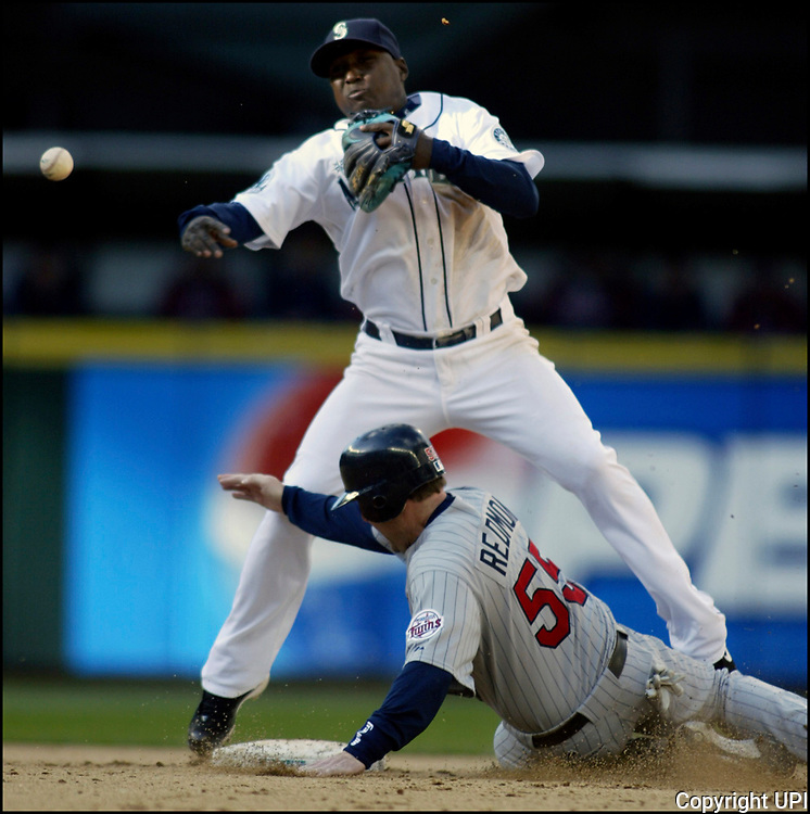 Minnesota Twins' Mike Redmond (55) is forced out at second base by Seattle Mariners shortstop Yuniesky Betancourt s he turns a double play in the seveth inning at Safeco Field in Seattle on April 19, 2007. Twins' Josh Rabe hit into the double play. The Twins beat the Mariners 6-5.  (UPI Photo/Jim Bryant)