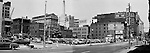 Pittsburgh PA:  View of the point area prior to the Gateway Center construction - 1949.  Eppy's parking lot at Liberty Avenue and Fancourt Street in Pittsburgh.  Joesph Horne's store is in the background.  Company signs on city buildings include; Commonwealth Heating Company, M.A. Baskind Company, Demmler and Schenck Company and Albert L Brahm Company