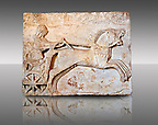Late  Greek Archaic relief sculpture in Proconnesian Marble of a charioteer ( Last quarter 6th Cent. B.C) From Cyzicus, ( Erdek formerly Art&agrave;ke, &Alpha;&rho;&tau;&kappa;&eta; in Greek) on the southern shore of the sea of Marmara, Turkey. Istanbul Archaeological Museum Inv. 2813T Cat. Bursa M.1.
