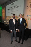 Olympic athlete and commentator Michael Johnson poses with Sky Tv's Ed Chamberlain before the start of his speech at the League Managers Association conference at the FA's new headquarters at St Georges Park in Burton.