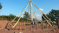 BNPS.co.uk (01202 558833)<br /> Pic: UpcottRoundhouse/BNPS<br /> <br /> Yabba-dabba-doo...<br /> <br /> Putting up the timber frame.<br /> <br /> A farmer has painstakingly recreated an Iron Age roundhouse to enable holidaymakers to release their inner Flintstone in the heart of the Devon countryside.<br /> <br /> Charles Cole has gone back over 2000 years to offer a back to basic's experience including a stone hearth fire, rudimentary plumbing, composting toilet and a six ton thatched roof to keep out the wind and rain.<br /> <br /> The amazing structure has been completely hand built by Charles and his family from materials sourced from their own farm and they have just opened up for bookings at &pound;170 a night.