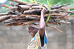 A woman carries firewood in the Congolese town of Kananga.