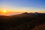Flores sunset over fog bank and eroded volcanoes
