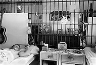 February 3rd 1968 Cummins, Arkansas, USA Inmates rest in the large communal room at the Cummins unit of Arkansas State Penitentiary. The corruption scandal of the historical penitentiary inspired the 1980 film Brubaker, which chronicled the warden's inside investigation into the corrupt southern prison system. <br /> Cummins, Arkansas. 3 f&eacute;vrier 1968.<br /> Une chambr&eacute;e commune de la prison. Les prisoniers n'ont pas de cellules individuelles.