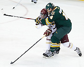 Brendan Silk (BC - 9), Ben Albertson (UVM - 18) - The Boston College Eagles defeated the University of Vermont Catamounts 4-1 on Friday, February 1, 2013, at Kelley Rink in Conte Forum in Chestnut Hill, Massachusetts.