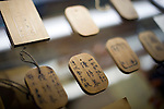 Photo shows old wooden season tickets to the baths at Dogo Onsen, thought to be Japan's oldest spa in Matsuyama City, Ehime Prefecture, Japan on 20 Feb. 2013.  Photographer: Robert Gilhooly