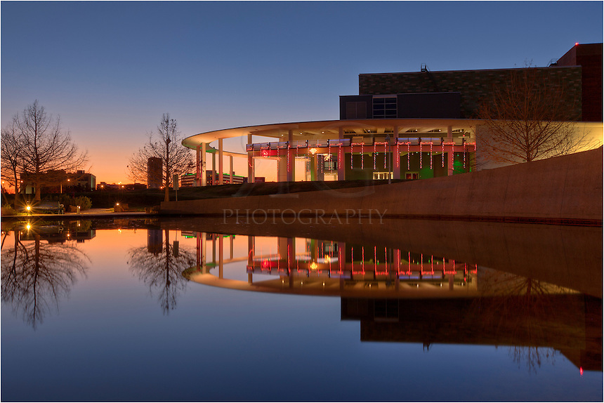 Just to the west of Austin's Long Center, there is a small pool. In the early morning hours, I happened to notice the perfect reflection in the pool and took a quick photo of the mirror-like scene.
