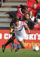 COLLEGE PARK, MD - OCTOBER 21, 2012:  Erika Nelson (15) of the University of Maryland is tripped by Jessica Price (6) of Florida State during an ACC women's match at Ludwig Field in College Park, MD. on October 21. Florida won 1-0.