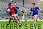I.S. Killorglin David Mangan istracked by Tralee CBS John Walsh and Sean Donnellan during Corn Uí Mhuírí Q/F in Fitzgerald Stadium on Wednesday