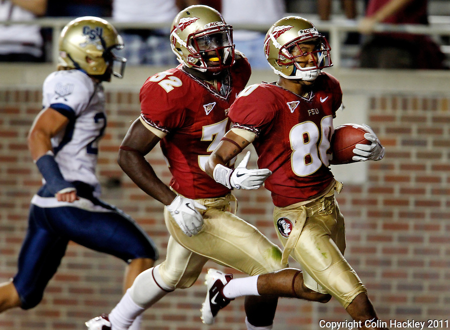 TALLAHASSEE, FL 10-FSU-CSU091011 CH-Florida State's Rashad Greene, right, enters the endzone with James Wilder, Jr. after Greene made a 69-yard pass and run against Charleston Southern during second half action Saturday at Doak Campbell Stadium in Tallahassee. The Seminoles beat the Buccaneers 62-10..COLIN HACKLEY PHOTO