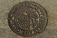 Manhole cover decorated with a salmon, Murakami-city, Niigata Prefecture, Japan, February 4, 2013. The snowy city in Northern Japan is famous for hot-springs, tea and salt salmon.