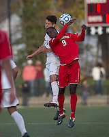 Boston College midfielder/defender Colin Murphy (21) and Rutgers University forward Ibrahim Kamara (9) battle for head ball.  Rutgers University defeated Boston College in penalty kicks after two overtime periods in NCAA Division I tournament action, at Newton Campus Field, November 20, 2011.