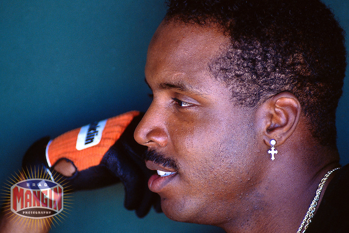 SCOTTSDALE, AZ - Barry Bonds of the San Francisco Giants talks to the media in the dugout before a spring training game at Scottsdale Stadium in Scottsdale, Arizona in 1993. Photo by Brad Mangin