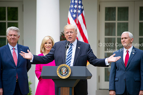 United States President Donald J. Trump makes remarks prior to signing a Proclamation designating May 4, 2017 as a National Day of Prayer and an Executive Order &quot;Promoting Free Speech and Religious Liberty&quot; in the Rose Garden of the White House in Washington, DC on Thursday, May 4, 2017.  From left to right: Pastor Jack Graham; Pastor Paula White of Florida&rsquo;s New Destiny Christian Center; President Trump; US Vice President Mike Pence.<br /> Credit: Ron Sachs / CNP