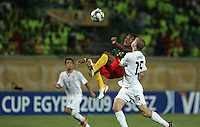 Cameroon's Adolphe Teikeu (12) makes a leap kick in front of the United States' Brian Ownby takes a shot by during the FIFA Under 20 World Cup Group C Match between the United States and Cameroon at the Mubarak Stadium on September 29, 2009 in Suez, Egypt.