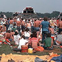 The right portion of Image C50-29. Scenes of the audience at the Labor Day Weekend Grateful Dead Concert, Englishtown NJ, 3 September 1977. The Stage in the distance and a Sound Relay Tower in the scene.