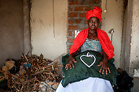 Dominga Tomu (48) has been a traditional healer since 1987. She is possessed by the spirit of a white Portuguese man who was killed by her grandfather during the civil war in Mozambique.