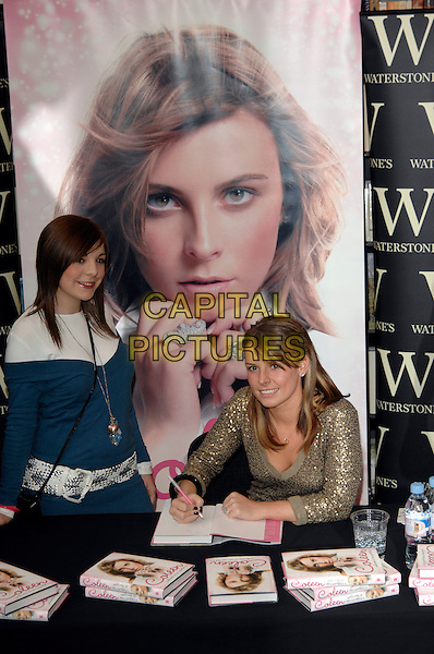 """COLEEN McLOUGHLIN.signs copies of her book """"Welcome to my World"""".at Waterstones bookshop, Oxford Street.8th March 2007 London, England.half length poster.CAP/PL.©Phil Loftus/Capital Pictures"""