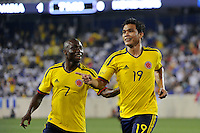Teofilo Gutierrez (19) of Colombia celebrates scoring with Pablo Armero (7). The men's national teams of Colombia (COL) defeated Honduras (HON) 2-0 during an international friendly at Red Bull Arena in Harrison, NJ, on September 03, 2011.
