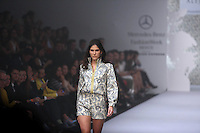 A model displays a creation by Mexican designer Alejandro Carlin during the Mercedes Benz Fashion Week Mexico Spring/Summer 2015, in Mexico City, 10.01.2014. VIEWpress / Miguel Angel Pantaleon