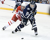 Reilly Smith (Miami - 18), Stevie Moses (UNH - 22) - The University of New Hampshire Wildcats defeated the Miami University RedHawks 3-1 (EN) in their NCAA Northeast Regional Semi-Final on Saturday, March 26, 2011, at Verizon Wireless Arena in Manchester, New Hampshire.