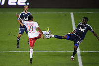 Gershon Koffie (28) of the Vancouver Whitecaps and Dane Richards (19) of the New York Red Bulls go for a ball. The New York Red Bulls  and the Vancouver Whitecaps played to a 1-1 tie during a Major League Soccer (MLS) match at Red Bull Arena in Harrison, NJ, on September 10, 2011.
