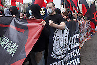 Moscow, Russia, 01/05/2011..Masked young anarchists chant slogans as a mixture of Communist and anarchist anti-government groups demonstrate in central Moscow. A variety of political groups took to the streets on the traditional Russian Mayday holiday.