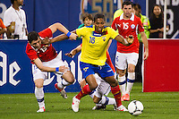 Antonio Valencia (16) of Ecuador battles for the ball with Jose Rojas (13) of Chile. Ecuador defeated Chile 3-0 during an international friendly at Citi Field in Flushing, NY, on August 15, 2012.