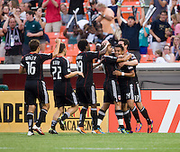Andy Najar (14) of D.C. United is congratulated by teammates after scoring the opening goal during the game at RFK Stadium in Washington, DC.  D.C. United was defeated by the San Jose Earthquakes, 4-2.