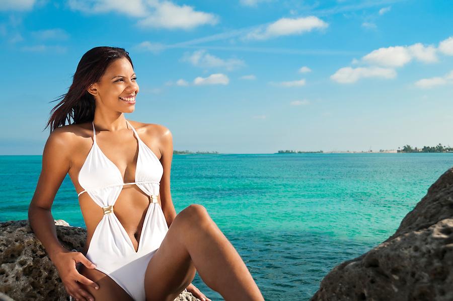 Young Bahamian woman enjoys the beach in Nassau.
