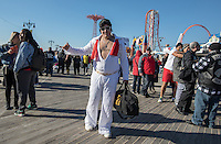 BROOKlLYN, NY - JANUARY 01 : A man wearing an Elvis costume takes part in the annual Coney Island Polar Bear Club New Year's Day swim by running into the ocean at Coney Island , Brooklyn on January 01, 2017. Photo by VIEWpress/Maite H. Mateo.