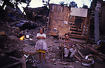 Central America, Honduras, Tegucigalpa. Elderly couple and their home destroyed. Devastation in the aftermath of Hurricane Mitch. High winds and flooding. Refugees. Husband and wife with broken home. Infrastructure destroyed.