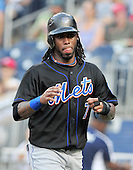 New York Mets shortstop Jose Reyes (7) returns to the dugout after scoring the first run in the first inning against Washington Nationals at Nationals Park in Washington, D.C. on Friday, July 29, 2011..Credit: Ron Sachs / CNP.(RESTRICTION: NO New York or New Jersey Newspapers or newspapers within a 75 mile radius of New York City)