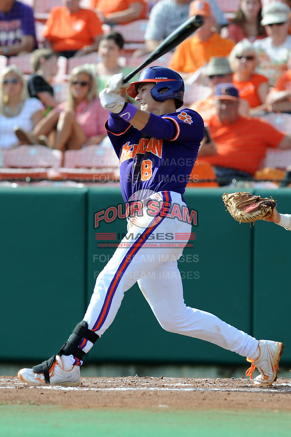 Third Baseman Richie Shaffer #8 swings at a pitch during a  game against the Miami Hurricanes at Doug Kingsmore Stadium on March 31, 2012 in Clemson, South Carolina. The Tigers won the game 3-1. (Tony Farlow/Four Seam Images)..