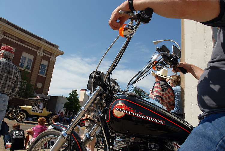 A biker watches the Bucking Horse Sale parade in Miles City, Montana.