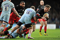 Chris Ashton of Saracens is tackled by Jaba Bregvadze of Worcester Warriors. Aviva Premiership match, between Saracens and Worcester Warriors on November 28, 2015 at Twickenham Stadium in London, England. Photo by: Patrick Khachfe / JMP