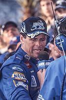 Michael Waltrip is interviewed in victory lane after winning the Daytona 500, Daytona 500, Daytona International Speedway, Daytona Beach, FL, February 18, 2001.  (Photo by Brian Cleary/ www.bcpix.com )