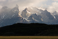 The Cuernos del Paine, or Paine Horns, peak from the mist at Torres del Paine National Park in southern Chile. (Kevin Moloney for the New York Times)
