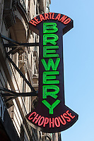 A sign for the Heartland Brewery Chophouse near Times Square in New York City